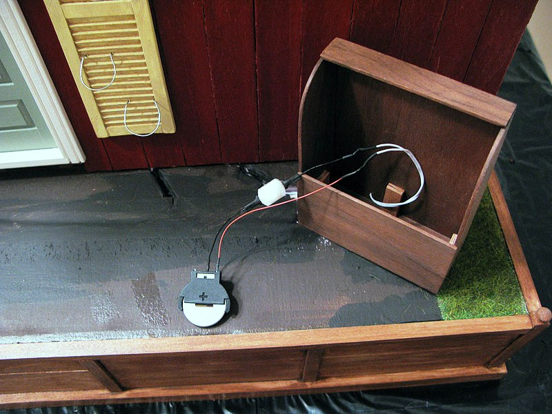 Firewood box with hidden switch