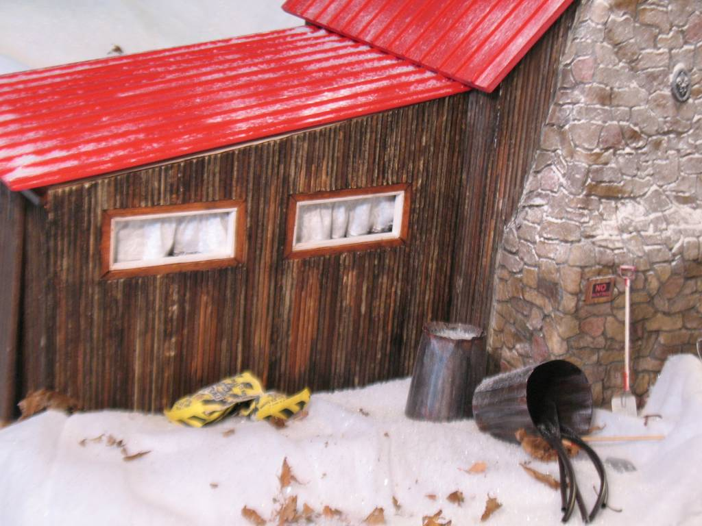 Rear exterior of shop with roof