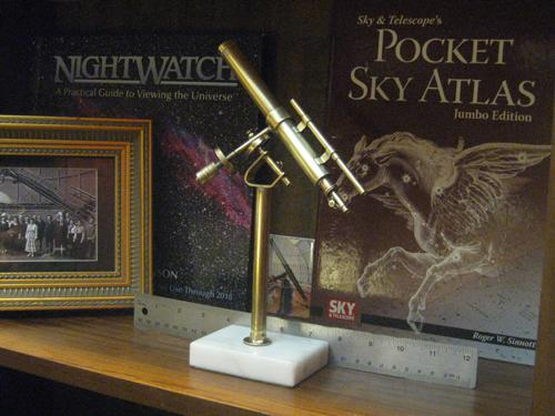 Telescope with ruler for scale reference